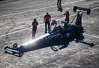 Aug 17, 2019; Brainerd, MN, USA; Crew members surround the dragster of NHRA top fuel driver Leah Pritchett during qualifying for the Lucas Oil Nationals at Brainerd International Raceway. Mandatory Credit: Mark J. Rebilas-USA TODAY Sports