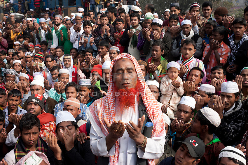 Bangladeshi Muslim men prays on the last day of World Congregation of Muslims, or Biswa Ijtema, on the banks of the River Turag just outside  Dhaka, Bangladesh. Jan 11, 2015