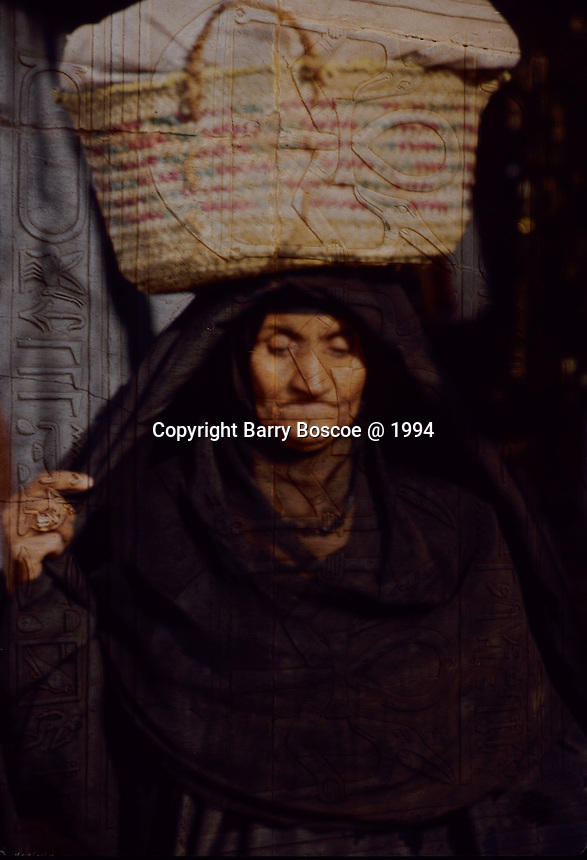 Muslim woman carring basket.