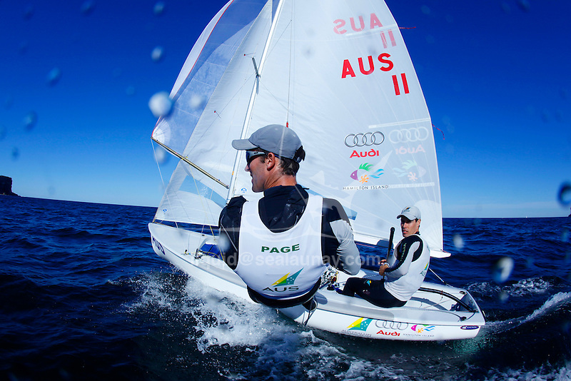 """Malcolm Page and Mathew Belcher training in Sydney Harbour by a Westerly breeze  on a sunny day for the world championship before heading to Europe...THE 470 DINGHY The 470 is an Olympic class dinghy recognised by ISAF, sailed by both male and female teams. It was designed in 1963 by the frenchman André Cornu, as a modern fiberglass planing dinghy. In 1969 the class was given international status and it has been an olympic class since featuring at the Montreal Olympics in 1976. In 1988 the first olympic womens sailing event was sailed in the 470..the 470 is sailed in more than 61 nations around the world..The boat is equipped with spinnaker and trapeze, which demands real teamwork. To be competitive, everything should be mastered to perfection and the 470 is often quoted as the hardest Olympic design to get to grips with. Tactically the boat is demanding as speed differences between competitors are small and fleets are usually big..To sail the 470, good physical health is enough; strength is not crucial. The competitive crew weight is 110 - 145 kg, making it ideal for both women and men..PARTICULARS.Length: 4.7m, 15'5"""".Length of waterline: 4.4m, 14'6"""".Mass: 120kg, 264lbs..Mast: 6.76m, 22'3"""".Total Sail Area: 12.7m^2, 137ft^2.Jib: 3.58m^2, 39ft^2.Main: 9.12m^2, 98ft^2.Spinnaker: 13m^2, 140ft^2.Crew .Two (single trapeze).Olympic Class..Malcolm Page (born 22 March 1972) is an Australian sailor. He was educated at St. Andrew's Cathedral School in Sydney. He and team mate Nathan Wilmot have won five world titles in the 470 class. They also won the Olympic test event in Qingdao in 2007 and were considered favourites to win the 470 event at the 2008 Summer Olympics, which they did...Mathew Belcher ..25.Nationality/Country.Australian/New Zealand.Being a natural sportsman, it no accident that Queenslander Mat Belcher is where he is today - campaigning for the 2008 Olympic Games. However Mat's first foray into sailing gave no indication of the talent to come- at seven, his par"""