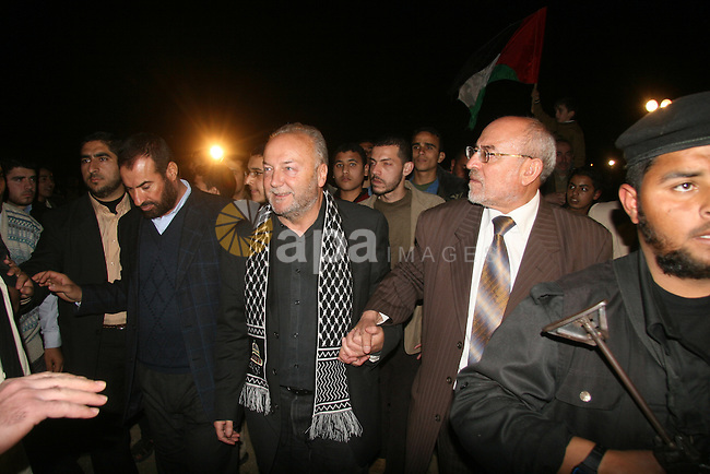 British lawmaker George Galloway, second from left, walks with a Hamas official after having crossed with his entourage from Egypt through the Rafah border crossing to Gaza, in Gaza City, Monday, March 9, 2009. On Monday, part of an aid caravan headed by activist British lawmaker George Galloway entered Gaza from Egypt. About 50 British volunteers and 100 vehicles carrying food, clothing and medicine passed through Egypt's Rafah border crossing, a Hamas border official said.  APAIMAGES PHOTO / Ashraf Amra
