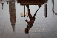"""The Terry Fox statue and the Parliament Peace Tower are reflected in a puddle of water in Ottawa Sunday September 26, 2010. Terrance Stanley """"Terry"""" Fox was a Canadian humanitarian, athlete, and cancer research activist.<br /> <br /> PHOTO :  Francis Vachon - Agence Quebec Presse"""