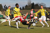 Lewis Smith of Hornchurch tussles with Helge Orome as he tries to get in a shot - AFC Hornchurch vs Bromley - Blue Square Conference South Football at The Stadium, Upminster Bridge, Essex - 01/04/13 - MANDATORY CREDIT: Gavin Ellis/TGSPHOTO - Self billing applies where appropriate - 0845 094 6026 - contact@tgsphoto.co.uk - NO UNPAID USE.