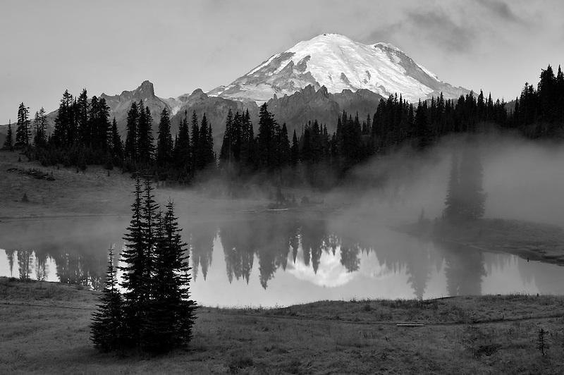 Mt. Rainier and Tipsoo Lake with sunrise and fog. Mt. Rainier National Park. Washington