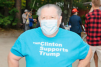 """Wayne Clinton, 74, of North Conway, NH, wears a shirt reading """"This Clinton Supports Trump"""" while the crowd awaits the arrival of Donald Trump, Jr., son of president Donald Trump and a rising Republican political star, at an outdoor campaign rally at The Lobster Trap in North Conway, New Hampshire, on Thu., Sept. 24, 2020. Wayne Clinton said he made the shirt during the 2016 campaign cycle."""