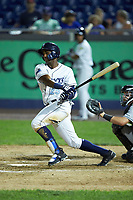 Seuly Matias (25) of the Wilmington Blue Rocks follows through on his swing against the Fayetteville Woodpeckers at Frawley Stadium on June 6, 2019 in Wilmington, Delaware. The Woodpeckers defeated the Blue Rocks 8-1. (Brian Westerholt/Four Seam Images)