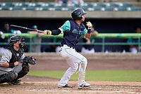 Second baseman Yordys Valdes (7) of the Lynchburg Hillcats in a game against the Delmarva Shorebirds on Wednesday, August 11, 2021, at Bank of the James Stadium in Lynchburg, Virginia. The catcher is Logan Michaels (10). (Tom Priddy/Four Seam Images)