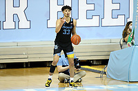 CHAPEL HILL, NC - FEBRUARY 24: Dawson Garcia #33 of Marquette takes a throw-in during a game between Marquette and North Carolina at Dean E. Smith Center on February 24, 2021 in Chapel Hill, North Carolina.