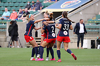 CARY, NC - APRIL 10: Trinity Rodman #2 of the Washington Spirit celebrates her goal with teammates Ashley Sanchez #10, Natalie Jacobs #4, and Ashley Hatch #33 during a game between Washington Spirit and North Carolina Courage at Sahlen's Stadium at WakeMed Soccer Park on April 10, 2021 in Cary, North Carolina.