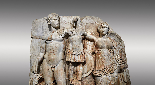 Close up of Roman Sebasteion relief sculpture of emperor Augustus and Goddess Victory, Aphrodisias Museum, Aphrodisias, Turkey. <br /> <br /> The naked emperor Augustus stands in majesty with the winged goddess Victory(Nike). He carried a spear and has an eagle, the bird representing Zeus, at his feet. Victory is crowning a military trophy - a rough post with enemy armour attached to it. Beneath the trophy is a barbarian captive, his hands tied behind his back.