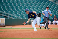 Montgomery Biscuits third baseman Michael Russell (5) fields a ground ball in front of third base umpire Tyler Jones during a game against the Biloxi Shuckers on May 8, 2018 at Montgomery Riverwalk Stadium in Montgomery, Alabama.  Montgomery defeated Biloxi 10-5.  (Mike Janes/Four Seam Images)
