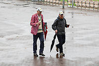 These fans head for shelter as heavy rain returns and promotes the abandonment of any prospect of play during India vs New Zealand, ICC World Test Championship Final Cricket at The Hampshire Bowl on 18th June 2021