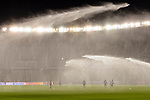 Players of Japan practice as sprinklers spray water during the AFC Asian Cup UAE 2019 Group F match between Oman (OMA) and Japan (JPN) at Zayed Sports City Stadium on 13 January 2019 in Abu Dhabi, United Arab Emirates. Photo by Marcio Rodrigo Machado / Power Sport Images