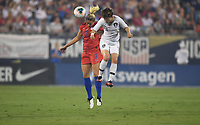 CHARLOTTE, NC - OCTOBER 03: Abby Dahlkemper #7 of the United States and MOON Mira #11 of Korea Republic battle for a ball during during a game between USA and Korea Republic at Bank of American Stadium, on October 03, 2019 in Charlotte, NC.