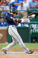 Minnesota Twins shortstop Tsuyoshi Nishioka #1 swings during a Major League Baseball game against the Texas Rangers at the Rangers Ballpark in Arlington, Texas on July 27, 2011. Minnesota defeated Texas 7-2.  (Andrew Woolley/Four Seam Images)