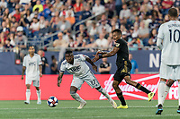 FOXBOROUGH, MA - AUGUST 4: Luis Caicedo #27 of New England Revolution breaks free of Mark-Anthony Kaye #14 of Los Angeles FC during a game between Los Angeles FC and New England Revolution at Gillette Stadium on August 3, 2019 in Foxborough, Massachusetts.