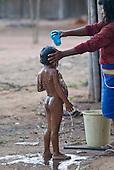Mato Grosso State, Brazil. Aldeia Metuktire. Bepte Txucarramae having a shower bath.
