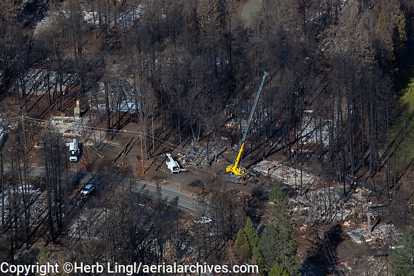 aerial photograph of a boom lift being used by Pacific Gas and Electric in the aftermath of the 2018 Camp Fire, Paradise, Butte County, California
