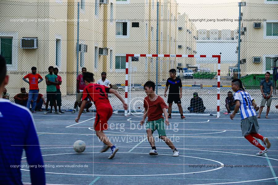 QATAR, Doha, housing complex for migrant worker outside the city, sports place / KATAR, Doha, Gastarbeiter, Sammelunterkunft fuer Gastarbeiter ausserhalb der Stadt, Sportplatz, Gastarbeiter aus den Philippinen und Vietnam spielen Fussball