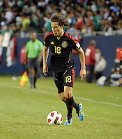 Mexico's Andres Guardado dirbbles the ball.  Mexico defeated Costa Rica 4-1 at the 2011 CONCACAF Gold Cup at Soldier Field in Chicago, IL on June 12, 2011.