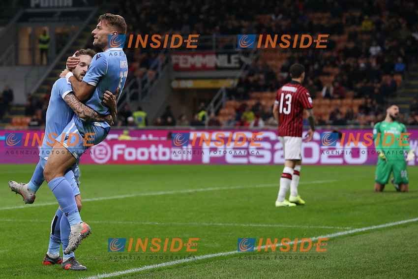 Ciro Immobile of Lazio celebrates with team mate Manuel Lazzari after heading the ball into the net from his cross to give the side a 1-0 lead during the Serie A match at Giuseppe Meazza, Milan. Picture date: 3rd November 2019. Picture credit should read: Jonathan Moscrop/Sportimage PUBLICATIONxNOTxINxUK SPI-0299-0015<br /> Milano 03-11-2019 Stadio San Siro <br /> Football Serie A 2019/2020 <br /> AC Milan - SS Lazio <br /> Photo Jonathan Moscrop / Sportimage / Imago  / Insidefoto <br /> ITALY ONLY