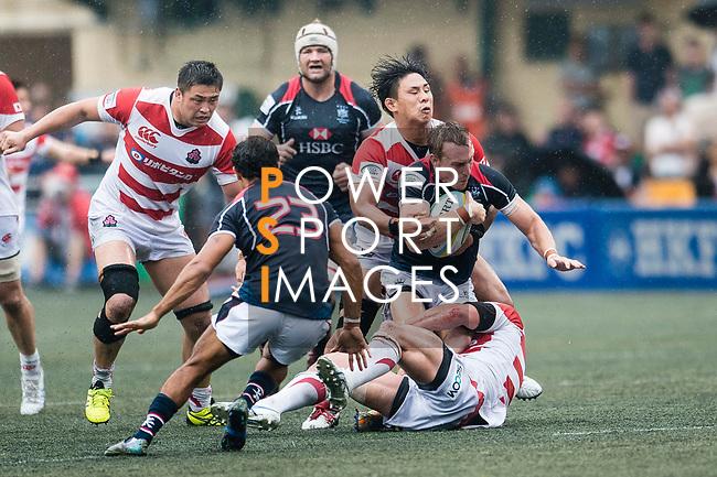 Naoki Ozawa of Japan (B) puts a tackle on Alex McQueen of Hong Kong (U) during the Asia Rugby Championship 2017 match between Hong Kong and Japan on May 13, 2017 in Hong Kong, China. Photo by Marcio Rodrigo Machado / Power Sport Images