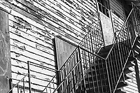 Steps to a door that doesn't open anymore.  One of the vacant buildings at the former Naval Air Station Alameda processed in black and white.