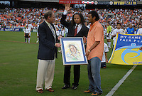 Los Angeles Galaxy Cobi Jones receives from DC United President Kevin Payne and former forward from DC United Marco Etcheverry a plaque for his retirement . DC United defeated the Los Angeles Galaxy 1-0, at RFK Stadium Washington DC, Thursday August 9, 2007.