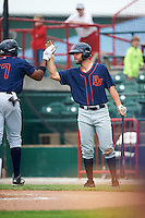 Bowing Green Hot Rods Manny Sanchez (17) high fives Daniel De La Calle (13) after hitting a home run during a game against the Burlington Bees on May 7, 2016 at Community Field in Burlington, Iowa.  Bowling Green defeated Burlington 11-1.  (Mike Janes/Four Seam Images)