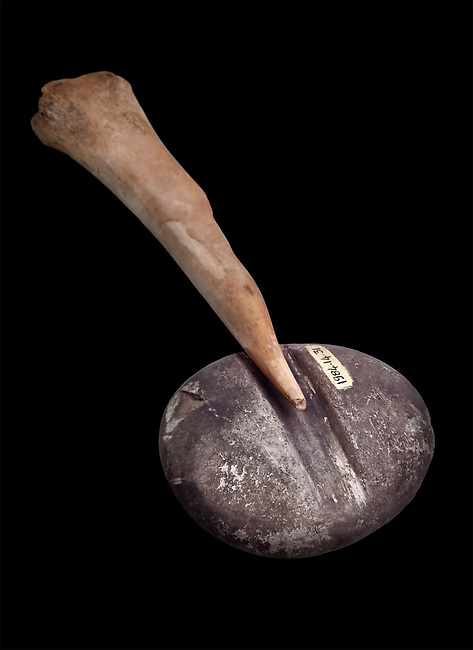 Neolithic stone tools, 7000 BC to 6500 BC. Catalhoyuk collection, Konya Archaeological Museum, Turkey. Against a black background