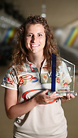 BNPS.co.uk (01202 558833)<br /> Pic: PWBA/BNPS<br /> <br /> Pictured: Verity Crawley with her trophy<br /> <br /> Britain's only professional ten-pin bowler has won her first ever title after the pandemic forced her to train in her parents' hallway.<br /> <br /> Verity Crawley had to return to the UK after her American athlete's visa was unexpectedly denied in January this year.<br /> <br /> The 26-year-old resorted to padding her parents' 10ft long hallway with pillows and cushions so she could train every day as bowling alleys were shut during lockdown.