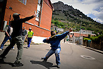 Spanish miners fire homemade rockets towards Spanish Civil Guards in Cinera, near Oviedo, northern Spain on June 19, 2012. Spanish coal miners burned tyres and blocked roads on June 18, 2012 during a mass strike to protest against subsidy cuts that they say threaten tens of thousands of jobs. Spain's cash-strapped central government has slashed subsidies to the coal sector this year to 111 million euros ($142 million) from 301 million euros last year, part of wide-ranging cuts to lower its deficit (c) Pedro Armestre