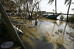 A Cyclone Nargis survivor walks in the village of Kamingo, at the Irrawaddy Division, May 10, 2008. Despairing survivors in Myanmar awaited emergency relief on Friday, a week after 100,000 people were feared killed as the cyclone roared across the farms and villages of the low-lying Irrawaddy delta region. The storm is the most devastating one to hit Asia since 1991, when 143,000 people were killed in neighboring Bangladesh. Photo by Eyal Warshavsky  *** Local Caption *** ëì äæëåéåú ùîåøåú ìàéì åøùáñ÷é àéï ìòùåú áúîåðåú ùéîåù ììà àéùåø