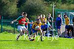 Padraig Doona Beaufort gets to the ball ahead of Eoghan O'Donovan Kilcummin during their IFC clash in Kilcummin on Saturday