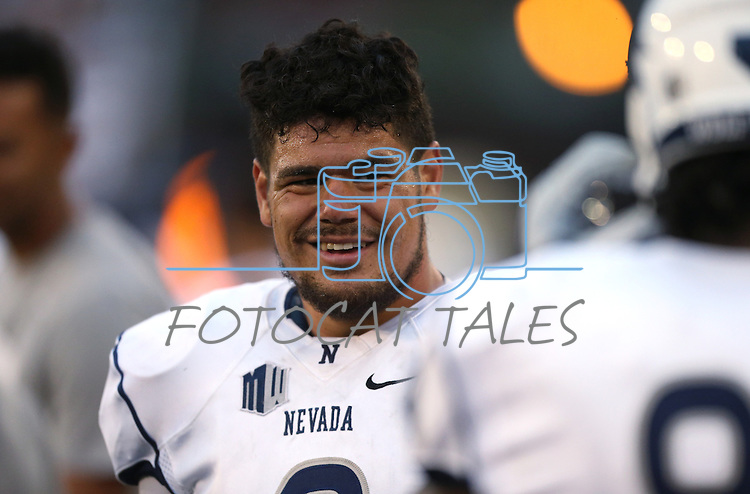 Nevada's Ian Seau warms up before an NCAA college football game against Arizona in Reno, Nev., on Saturday, Sept. 12, 2015.(AP Photo/Cathleen Allison)