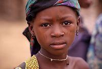 Dan Gaya, Niger, West Africa.  Young Hausa Girl with Facial Scarification as Tribal Identify Marks.