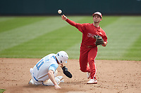 J.T. Jarrett (15) of the North Carolina State Wolfpack makes a throw to first base after forcing out Caleb Roberts (11) of the North Carolina Tar Heels at second base at Boshamer Stadium on March 27, 2021 in Chapel Hill, North Carolina. (Brian Westerholt/Four Seam Images)