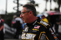 Mar. 9, 2012; Gainesville, FL, USA; NHRA crew chief Mike Green for top fuel dragster driver Tony Schumacher during qualifying for the Gatornationals at Auto Plus Raceway at Gainesville. Mandatory Credit: Mark J. Rebilas-