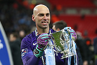 Wilfredo Caballero of Manchester City celebrates holding the trophy after winning the Capital One Cup by beating Liverpool on penalties at Wembley Stadium, London, England on 28 February 2016. Photo by David Horn / PRiME Media Images.
