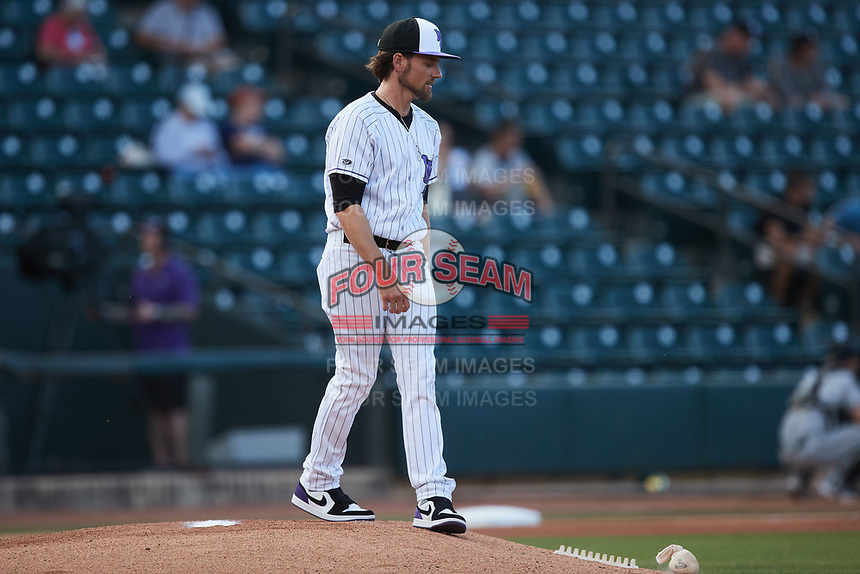 Winston-Salem Dash pitching coach Danny Farquhar (3) delivers the rosin bag to the mound prior to the game against the Greensboro Grasshoppers at Truist Stadium on June 15, 2021 in Winston-Salem, North Carolina. (Brian Westerholt/Four Seam Images)