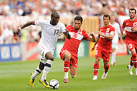 Jozy Altidore (17) of the United States is chased by Arda Turan (14) of Turkey  during an international friendly between the men's national teams of the United States (USA) and Turkey (TUR) at Lincoln Financial Field in Philadelphia, PA, on May 29, 2010.