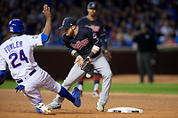 Cleveland Indians second baseman Jason Kipnis (22) cannot come up with a throw as Dexter Fowler (24) steals second base in the seventh inning during Game 5 of the Major League Baseball World Series against the Chicago Cubs on October 30, 2016 at Wrigley Field in Chicago, Illinois.  (Mike Janes/Four Seam Images)