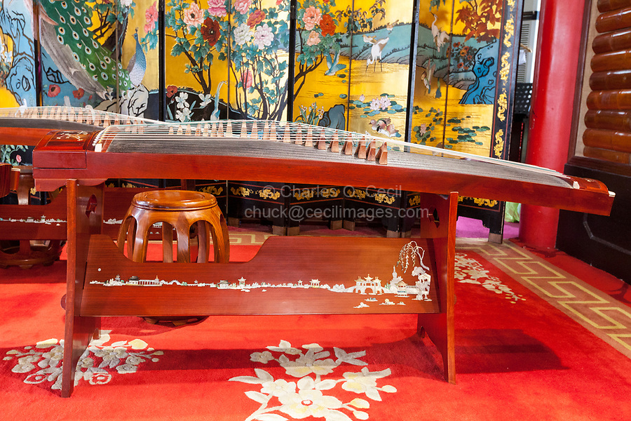 Yangzhou, Jiangsu, China.  Guzheng, a Traditional Chinese Stringed Instrument.  Slender West Lake Park.