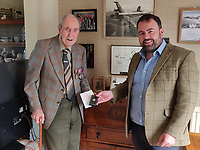 BNPS.co.uk (01202) 558833<br /> Pic: Deborah Follett/BNPS<br /> <br /> Pictured: Former Squadron Leader Ken Symonds receives the medal from Chris Loder MP<br /> <br /> An RAF veteran who flew the last Lancaster bomber home on the final sortie of the war has finally received his Bomber Command clasp 75 years later.<br /> <br /> Former Squadron Leader Ken Symonds, 97, limped his aircraft back to Britain following the last big raid of Bomber Command's Europe offensive.<br /> <br /> The sortie took place over Berchestgaden, the town in the Bavarian Alps where Adolf Hitler had his Eagles Nest retreat, on April 25, 1945 - five day's before the evil dictator's suicide.<br /> <br /> The Lancaster was struck by anti-aircraft fire which resulted in one of its four engines to be knocked out.