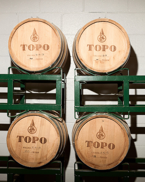 June 18, 2013. Chapel Hill, North Carolina<br />  American whiskey ages in white oak barrels at TOPO Distillery.<br />  TOPO, Top of the Hill Distillery, the brainchild of owner Scott Maitland and Spirit Guide Esteban McMahan, is located in the old N&O Building on Franklin Street. Making gin, vodka and American whiskey from locally sourced wheat, they are one of the few distilleries bringing  organic liquor to ABC shelves around the state.