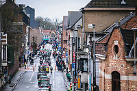 Peloton rolling through town<br /> <br /> GP Monseré 2020<br /> One Day Race: Hooglede – Roeselare 196.8km. (UCI 1.1)<br /> Bingoal Cycling Cup 2020