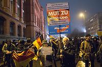 """Etwa 200 Anhaenger des Berliner Ablegers rechten Pegida-Bewegung, Baergida, versammelten sich am Montag den 5. Januar 2015 in Berlin zu einer Demonstration gegen eine angebliche Islamisierung Deutschlands und dagegen, dass """"in 30 Jahren in Deutschland die Sharia herrscht"""", so der Organisator Karl Schmitt.Bis zu 5.000 Menschen protestierten gegen den rechten Ausmarsch und blockierten bei Regen die Marschroute mehrere Stunden. Die Polizei schaffte es nicht mit koerperlicher Gewalt die Blockade zu beenden, so dass die Rechten nach drei Stunden nach Hause gehen mussten. Die Baergida-Anhaenger, """"Berlin gegen die Islamisierung des Abendlandes"""", feierten dies aber dennoch als Sieg. Waren zur ersten Baergida-Aktion eine Woche zuvor nur 5 Menschen gekommen.<br /> Unter den Anhaengern von Baergida waren viele bekannte militante Neonazis und Hooligans sowie Mitglieder der Rechtsparteien AfD und Pro Deutschland und der rechtsradikalen German Defense League. Immer wieder wurde skandiert """"Luegenpresse, auf die Fresse"""" und dass die Journalisten nach Israel verschwinden sollen.<br /> Im Bild: Ein AfD-Mitglied mit einem Plakat seiner Partei.<br /> 5.1.2015, Berlin<br /> Copyright: Christian-Ditsch.de<br /> [Inhaltsveraendernde Manipulation des Fotos nur nach ausdruecklicher Genehmigung des Fotografen. Vereinbarungen ueber Abtretung von Persoenlichkeitsrechten/Model Release der abgebildeten Person/Personen liegen nicht vor. NO MODEL RELEASE! Nur fuer Redaktionelle Zwecke. Don't publish without copyright Christian-Ditsch.de, Veroeffentlichung nur mit Fotografennennung, sowie gegen Honorar, MwSt. und Beleg. Konto: I N G - D i B a, IBAN DE58500105175400192269, BIC INGDDEFFXXX, Kontakt: post@christian-ditsch.de<br /> Bei der Bearbeitung der Dateiinformationen darf die Urheberkennzeichnung in den EXIF- und  IPTC-Daten nicht entfernt werden, diese sind in digitalen Medien nach §95c UrhG rechtlich geschuetzt. Der Urhebervermerk wird gemaess §13 UrhG verlangt.]"""