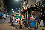 Rickshaw pullers sit idle at a lane in Sonagachi, Kolkata. Sonagachi is the biggest red light area in Asia and gone out of business as India is going through a 21 days lock down due to covid 19 pandemic. Kolkata, West Bengal, India. Arindam Mukherjee.