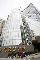 Pedestrians walk past the Crown Casino in Macau.<br /> May 08, 2007