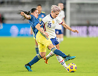 ORLANDO, FL - JANUARY 22: Diana Ospina #4 of Colombia fights for the ball with Megan Rapinoe #15 of the USWNT during a game between Colombia and USWNT at Exploria stadium on January 22, 2021 in Orlando, Florida.